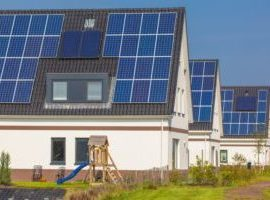 new houses with solar panels in a street playground