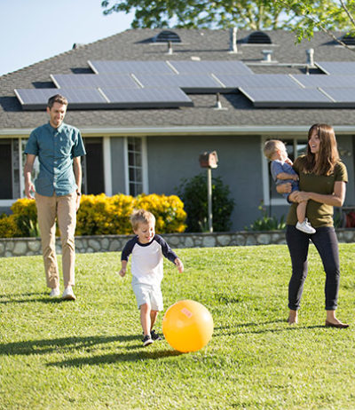 smiling family solar panels house solar kids background playing caucasian family son yellow ball